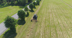 Farm tractor working in the field. Aerial footage Footage