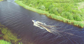 Aerial view of luxury speed boat cruising in the river Footage