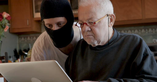 Thief lurking and creeping in a older man's home stealing his privacy data Live Action