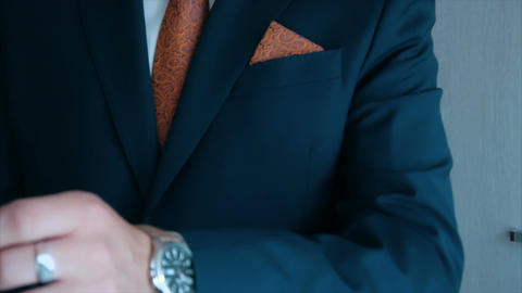 groom wears watch on his left hand at wedding Footage
