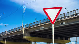 Road sign giving way, traffic regulation. Traffic Laws. Regulation of traffic of Live Action