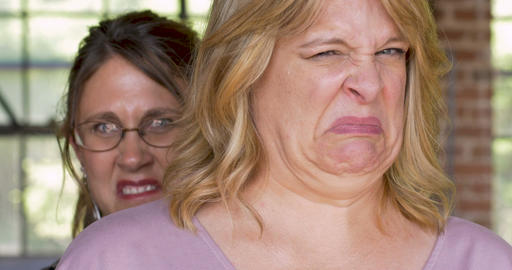 Two women expressing disgust and disapproval with negative facial expressions Footage