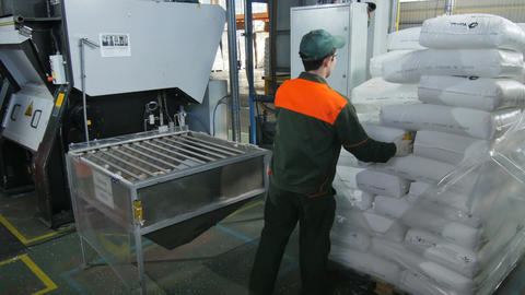 Worker Comes and Pours out Granulated Polyethylene Footage