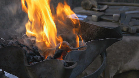 Burning coal in the hearth of a blacksmith Image