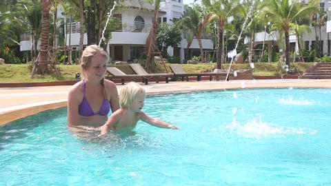 Mother and Little Girl Bathe in Pool under Streams Footage