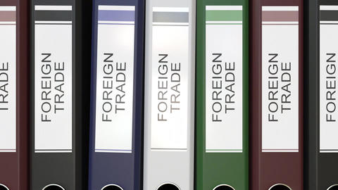 Multiple office folders with Foreign trade text labels Live Action