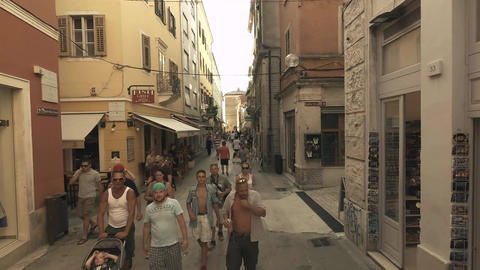 PULA, CROATIA - AUGUST 2, 2017. Crowded tourist street overhead view Footage
