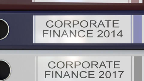 Vertical stack of multicolor office binders with Corporate finance tags Footage