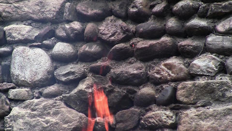 An old wall of stone found in woods and beside him a consuming fire 5 Live Action
