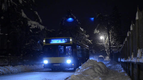 Auto traffic in a city covered with snow 4 Footage