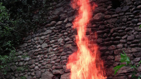 An old wall of stone found in woods and beside him a consuming fire 4 Live Action