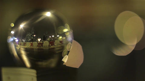 Car traffic at night in winter in a city seen through a glass bubbleow 114 Footage