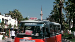 Turkey the Aegean Sea Bodrum 011 busy palm avenue with mosque Footage
