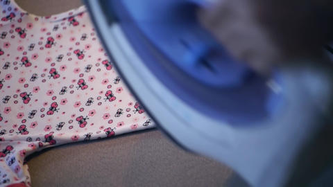 Caucasian woman indoors ironing some clothes 8 Stock Video Footage