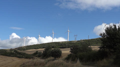 Collection of rural wind turbines. Wind turbines seen in the distance on a hill  Footage