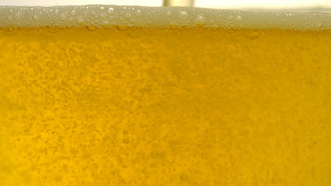 Golden light beer being poured into a glass Footage