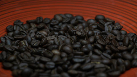 Coffee Beans Close Up Rotating on a Red Plate Live Action