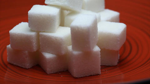 Sugar Cubes on a Red Plate Close Up Rotating Footage