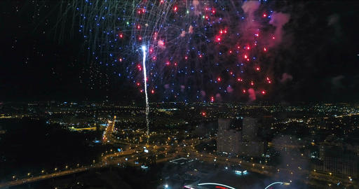 Fireworks over the evening city. Aerial view Footage