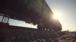 Low angle view of a train and rail cars passing Footage