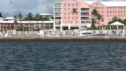 Bermuda Hamilton ferry arrival in Hamilton along Hotels and yachts Footage