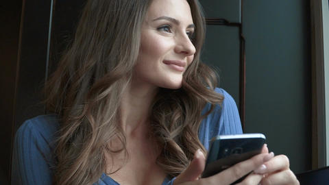 Young attractive woman using phone ビデオ