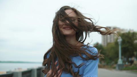 Young beautiful woman shaking her beautiful hair Stock Video Footage