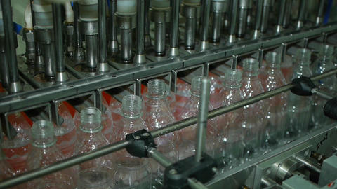 Automatic conveyor line for filling water and lemonade in a plastic bottle Footage
