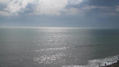 view from above on the sea. The sun is reflected in the small waves. The Footage