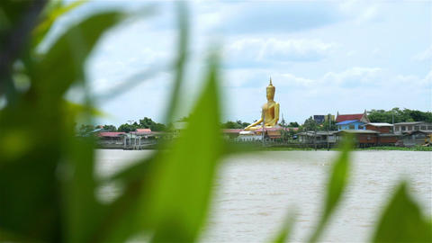 Golden buddha at Chao Phraya waterfront in Thailand Filmmaterial