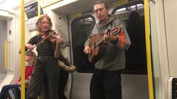 Buskers on London Underground metro train London UK Archivo