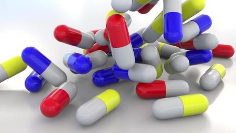 Falling multicolor drug capsules or pills Image
