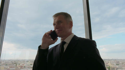 Mature businessman taling on phone Footage