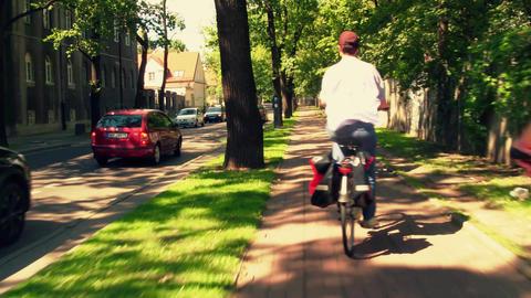People cycling along urban bike path Footage