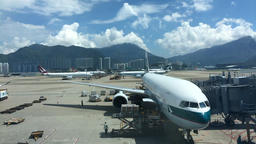 Loading cargo onto a Cathay Pacific plane at Hong Kong International Airport Footage