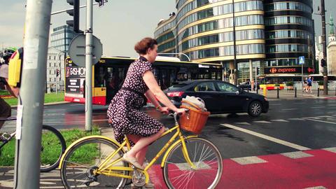 WARSAW, POLAND - JULY 11, 2017. People riding bicycles along urban bike paths Footage