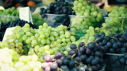 White and black grapes stall at the local farmers market Image