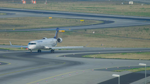 Bombardier CRJ-900 taxiing after landing Footage