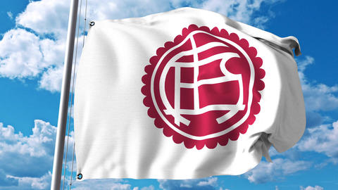 Waving flag with Club Atletico Lanus football club logo. 4K editorial clip Live Action
