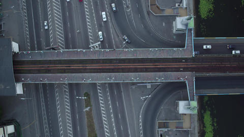 Aerial Vertical View of Car Traffic on City Road and metro railway station Archivo