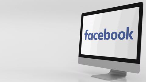Modern computer screen with Facebook logo. 4K editorial clip Live Action