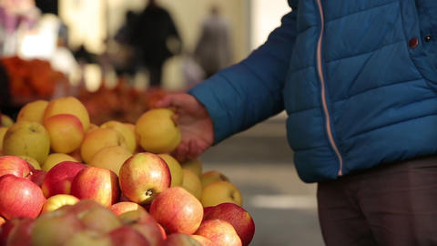 man in the market selects apples Footage