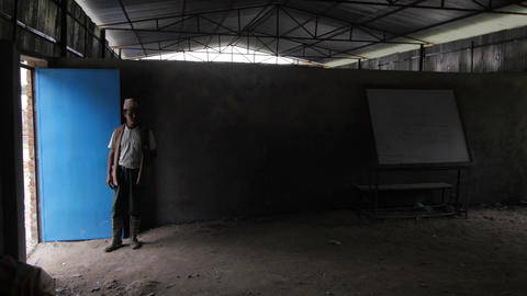 Man standing by the door in a Nepali classroom Footage