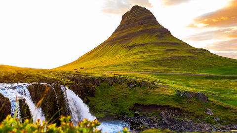 View of Kirkjufell mountain and Kirkjufell waterfalls in West Iceland Footage