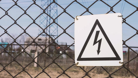High - voltage substation. Warning sign of danger. Electric shock. Electrical Footage