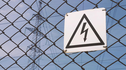 Warning sign for high voltage. Danger. High voltage at the substation Footage