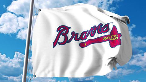 Waving flag with Atlanta Braves professional team logo. 4K editorial clip Footage