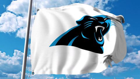 Waving flag with Carolina Panthers professional team logo. 4K editorial clip Live Action