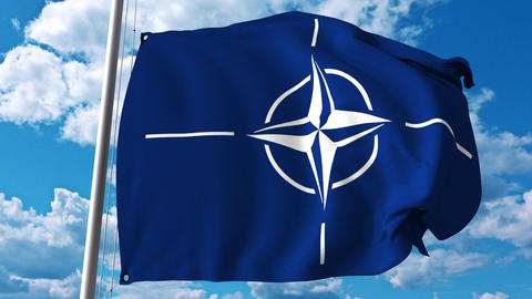 Waving flag with NATO logo. 4K editorial clip Footage