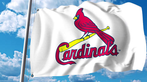 Waving flag with St. Louis Cardinals professional team logo. 4K editorial clip Footage